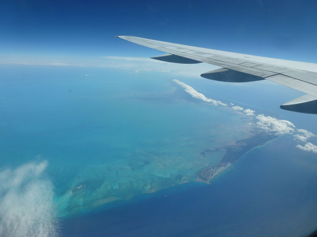 airplane wing over island